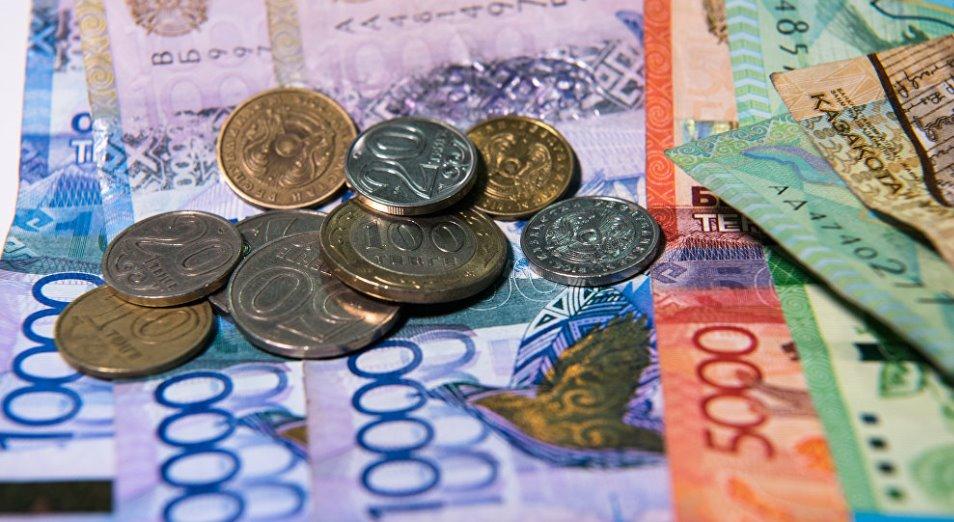 Курс тенге в понедельник понизился на 0,04%, до 380,67/$1