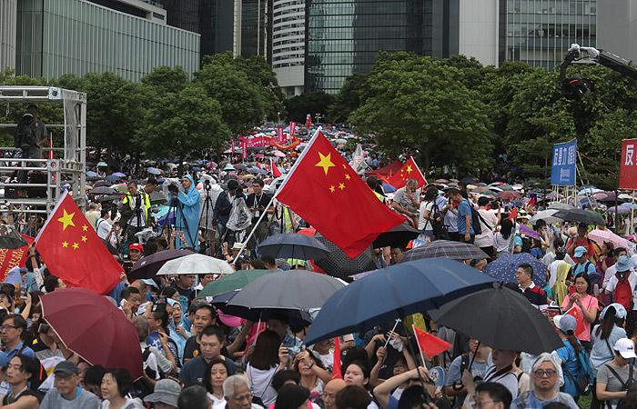 Пекин сменил главу канцелярии центрального правительства Китая в Гонконге